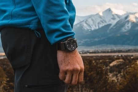 man with blue sweater wearing a watch