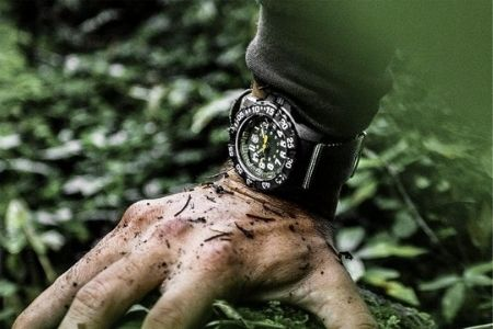 dirty hand with watch